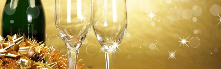 Champagne glasses on golden background